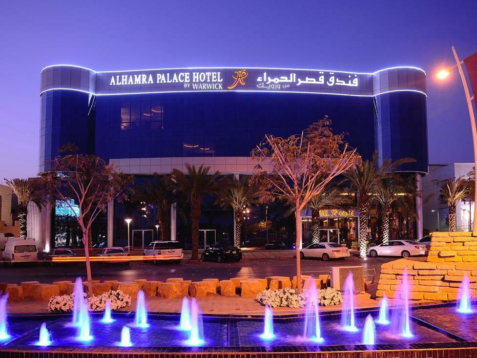 Al Hamra Palace by Warwick Hotel Facade by Night