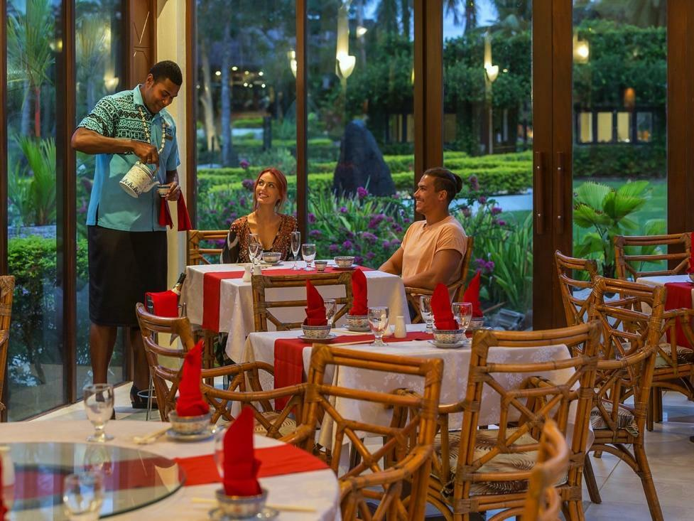Bamboo Restaurant with Couple at Naviti Resort
