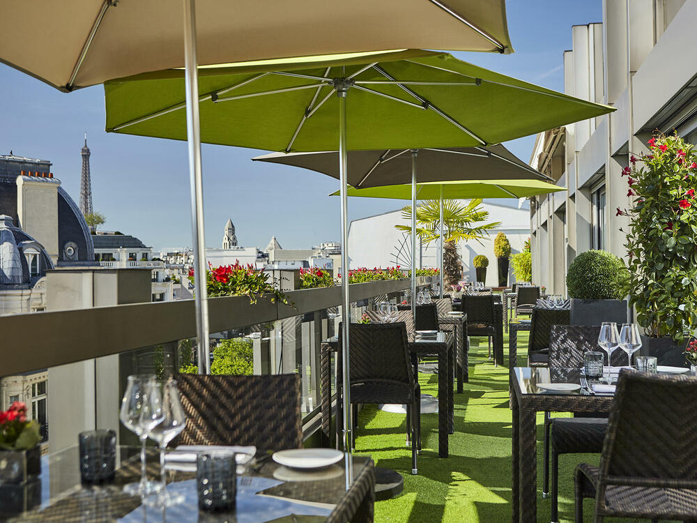 Terrace with Eiffel Tower view at Warwick Paris