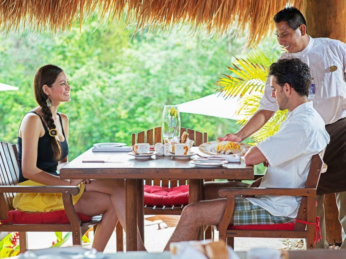 Couple enjoying breakfast at La Coleccion Resorts