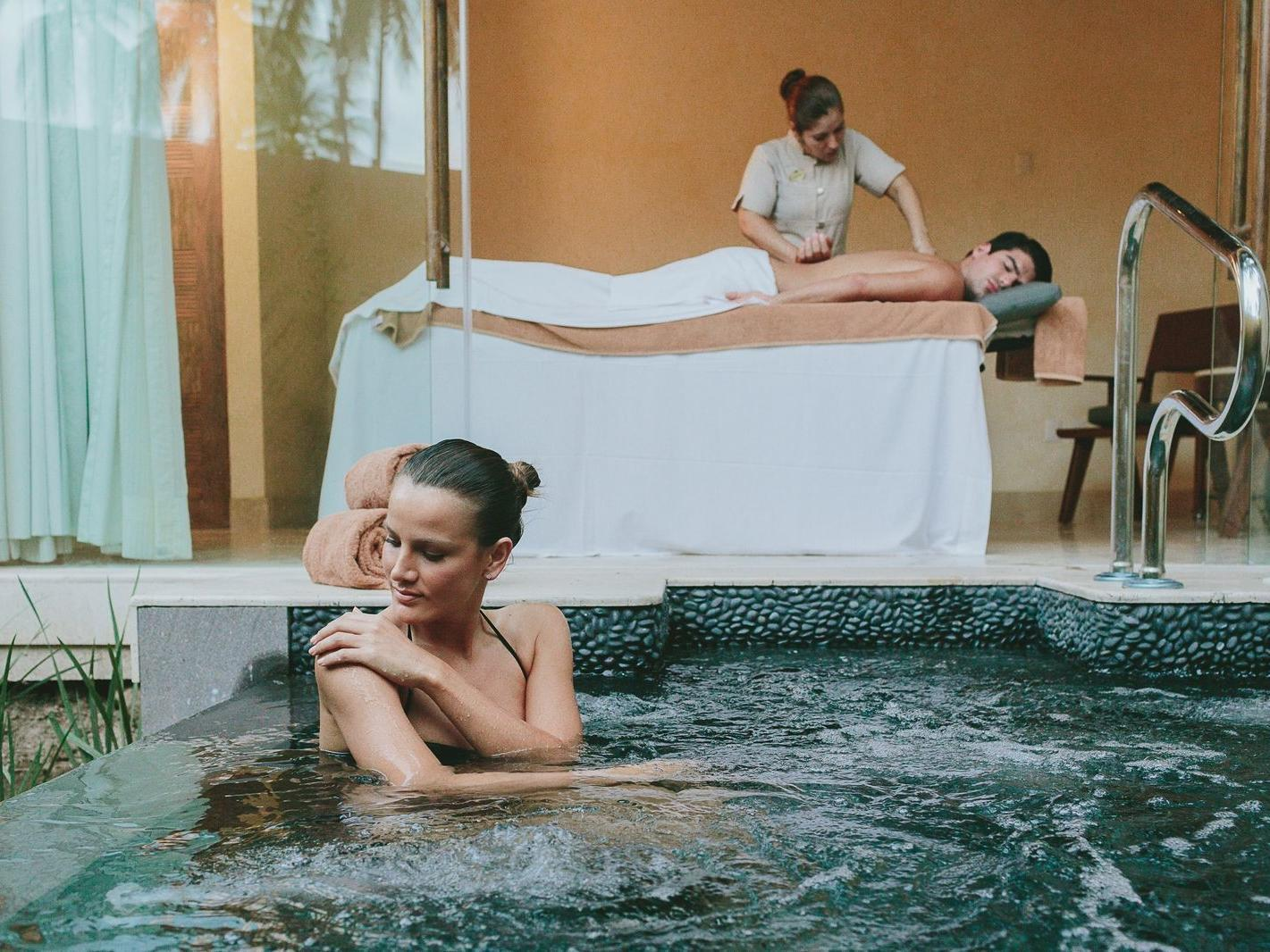 Woman in Spa and Man getting massage