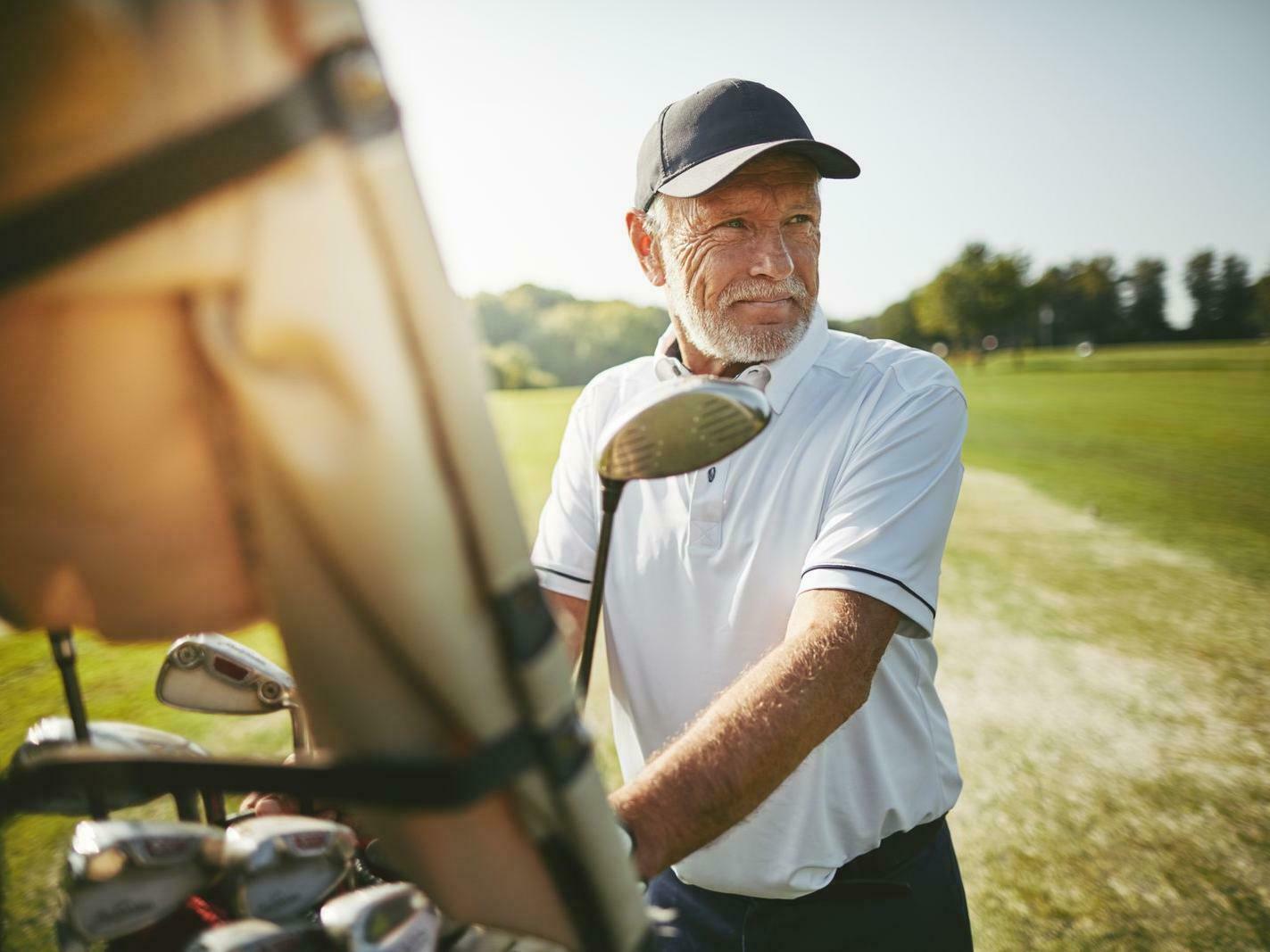 man standing near golf cart