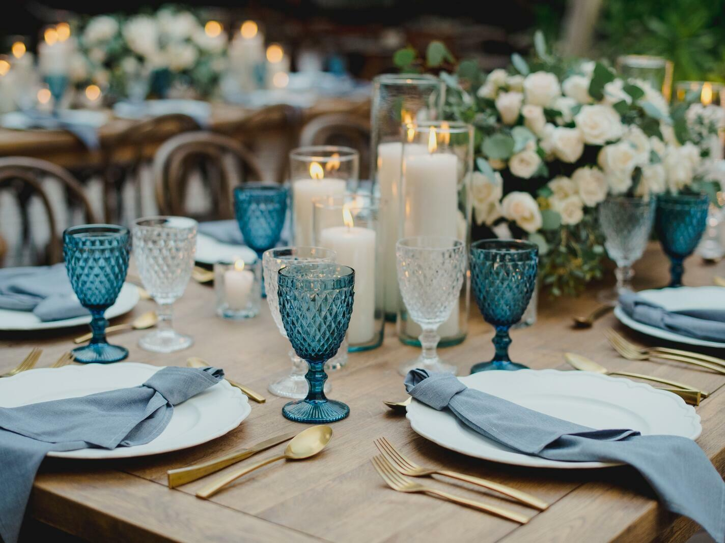 table decorated with place setting and centerpiece