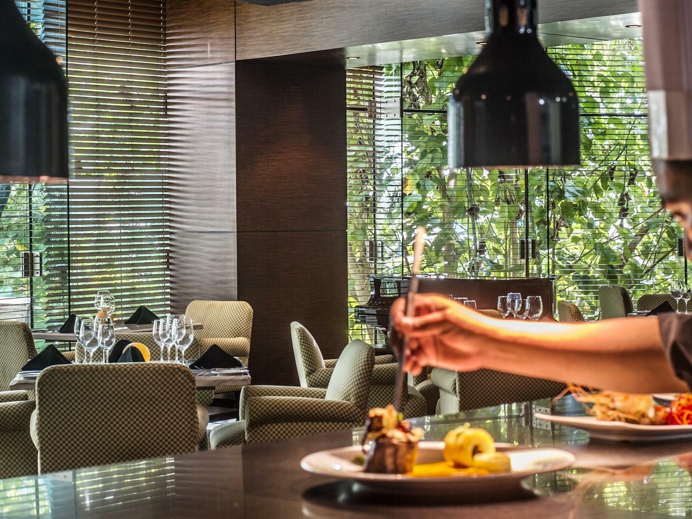 chef plating food on bar