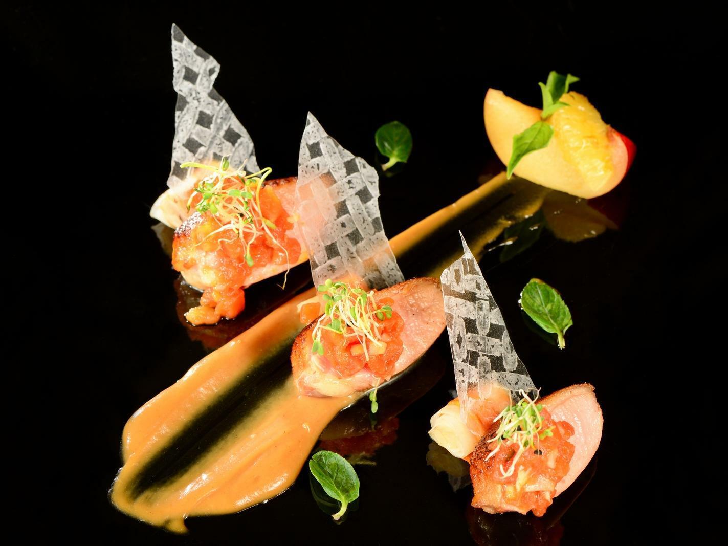 artfully plated food on black plate