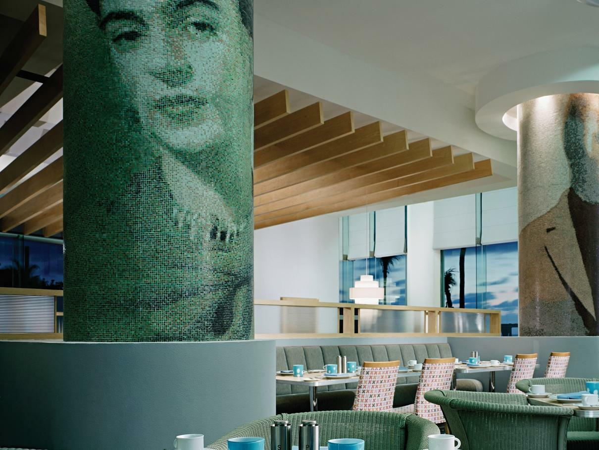 restaurant dining room with frida kahlo portrait on wall