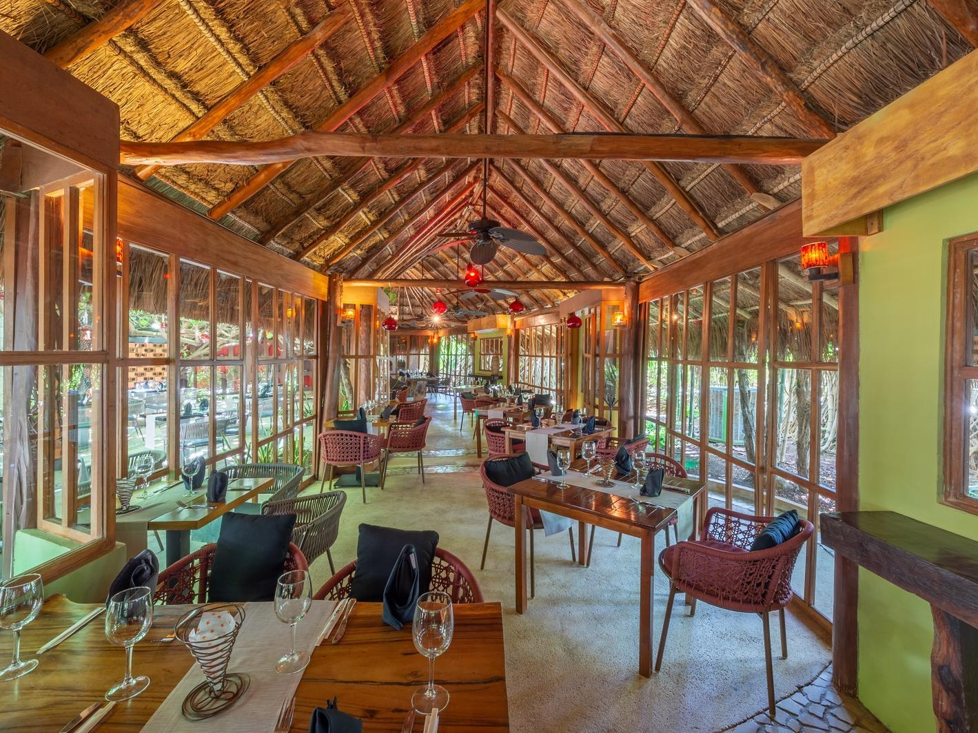 restaurant dining room with straw canopy roof