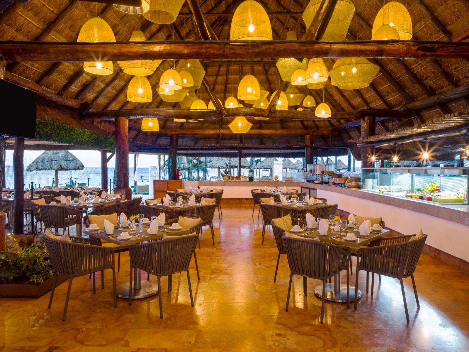 restaurant with buffet and dining tables