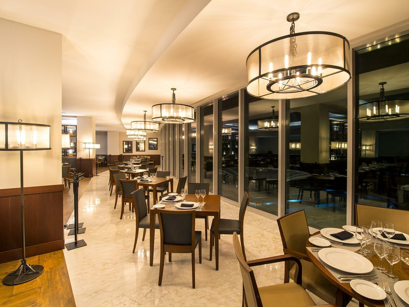 Restaurant dining room with floor to ceiling windows at Gulietta at Grand Fiesta Americana Puerto Vallarta All Inclusive Adults Only