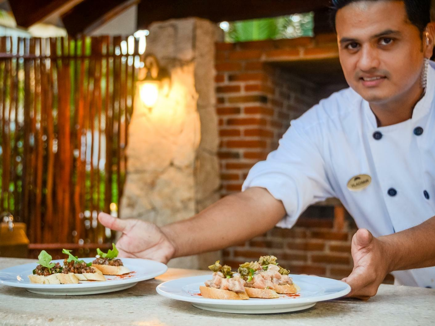 chef serving plates of food