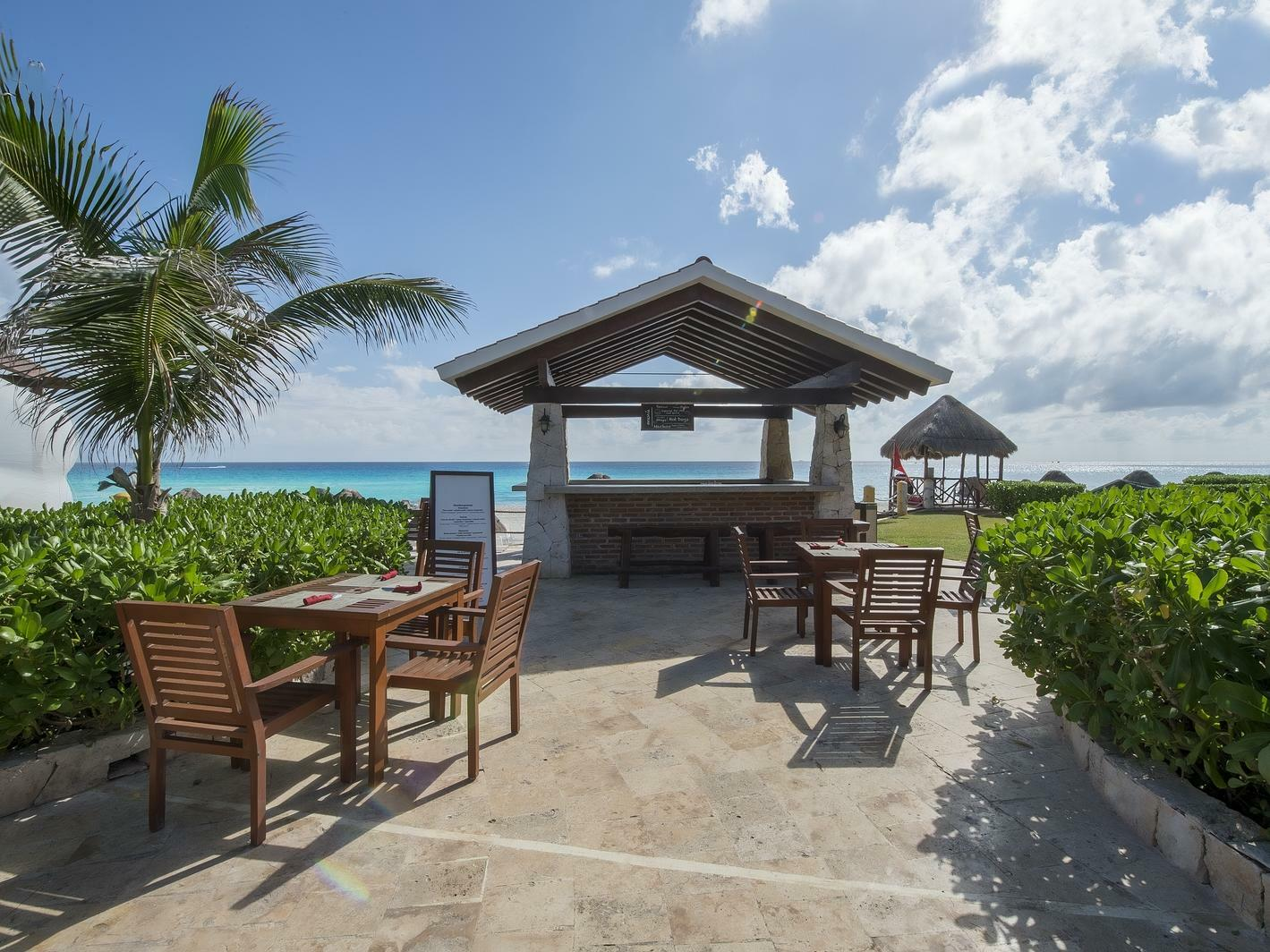 outdoor bar and dining tables with ocean view