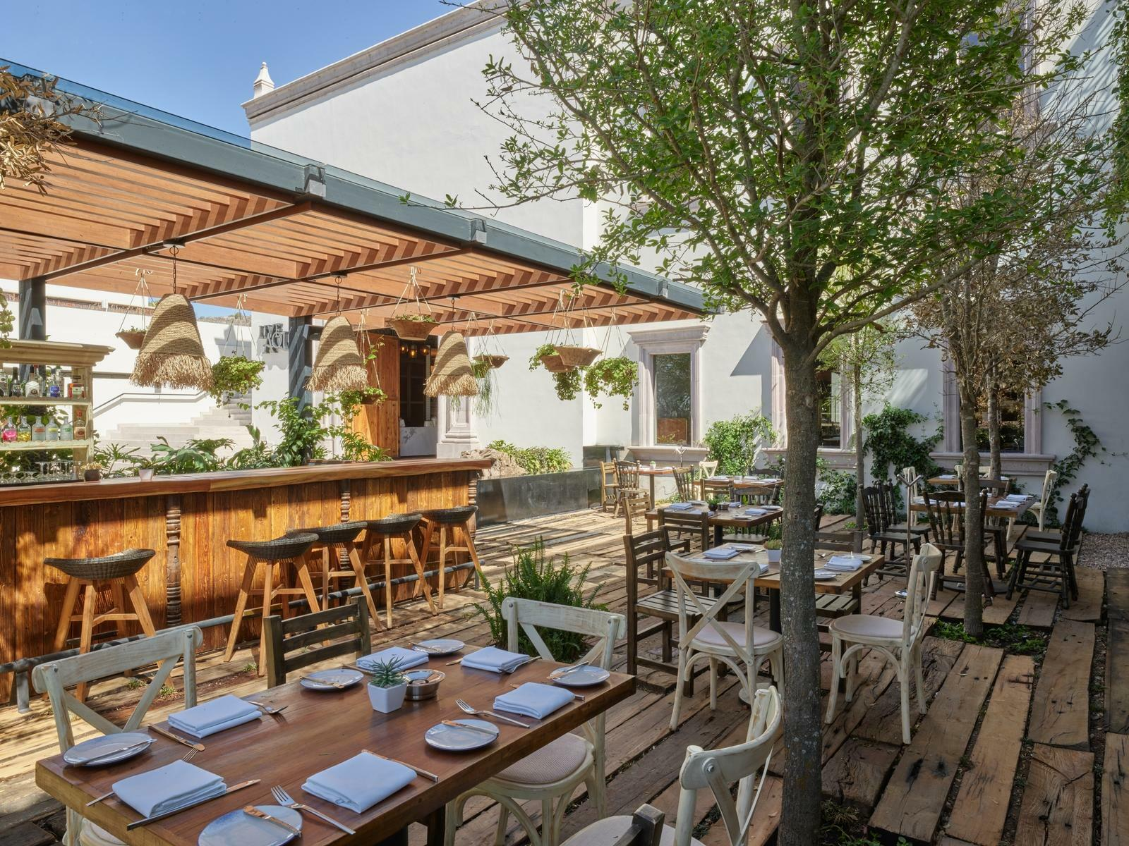outdoor restaurant with dining tables and bar