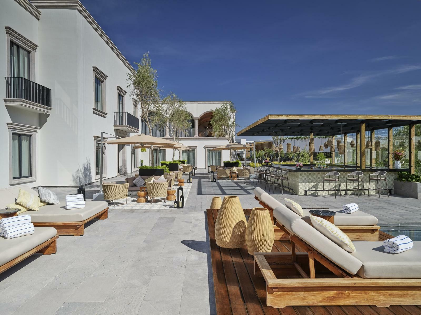 outdoor lounge and bar near pool