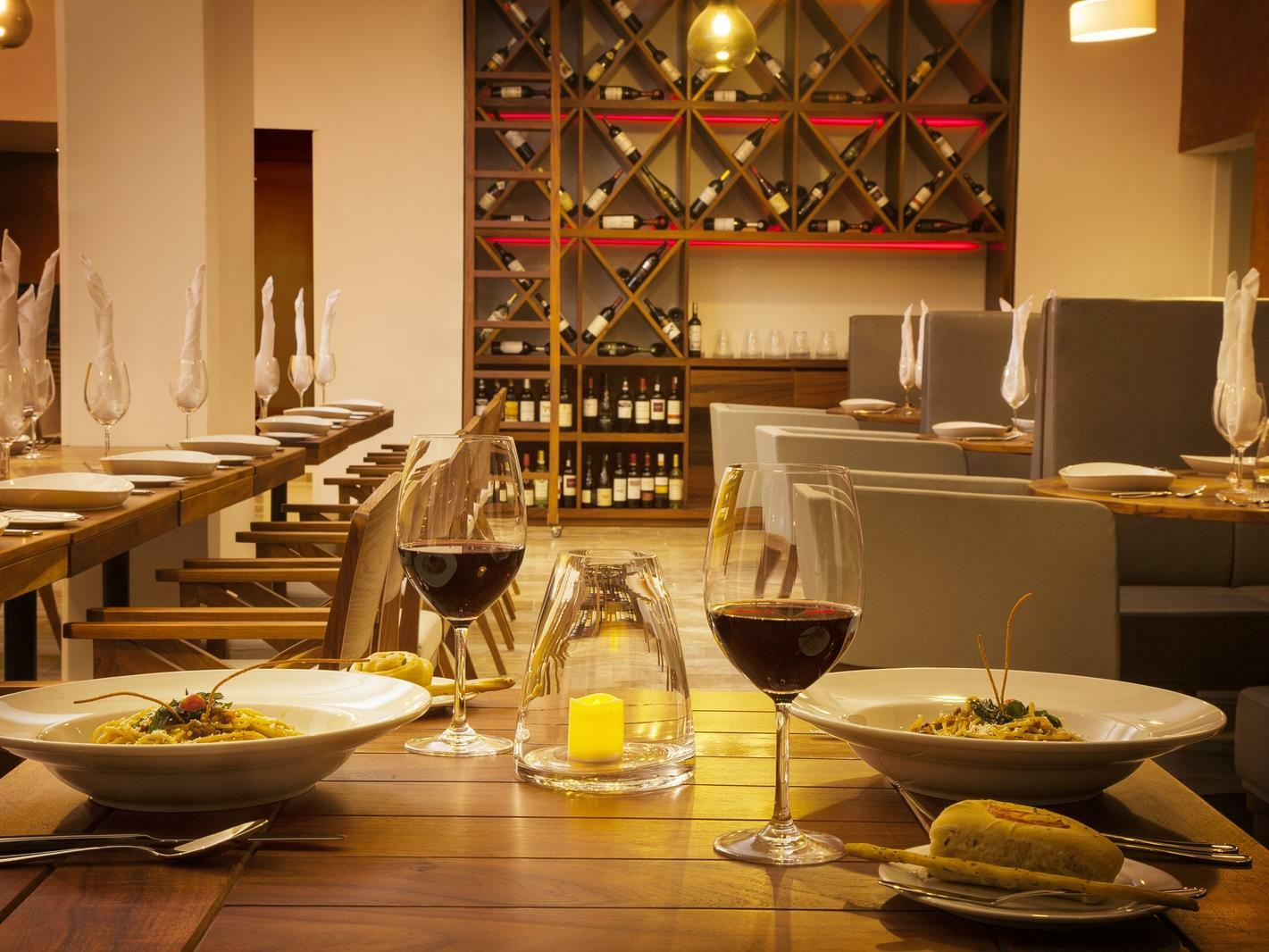 dining table with food and wine glasses