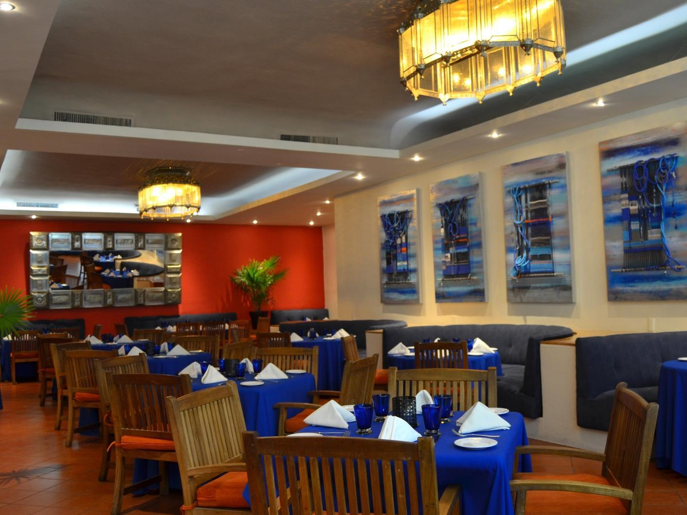 restaurant dining tables with blue table linens