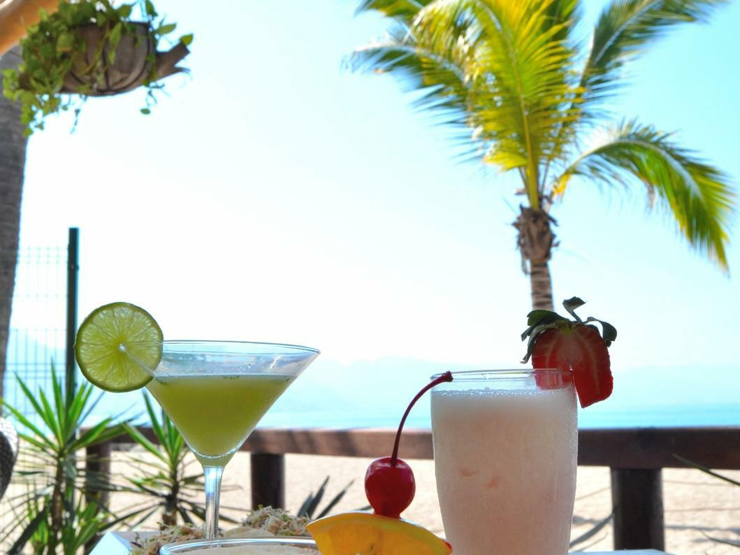 cocktails on table with beach view