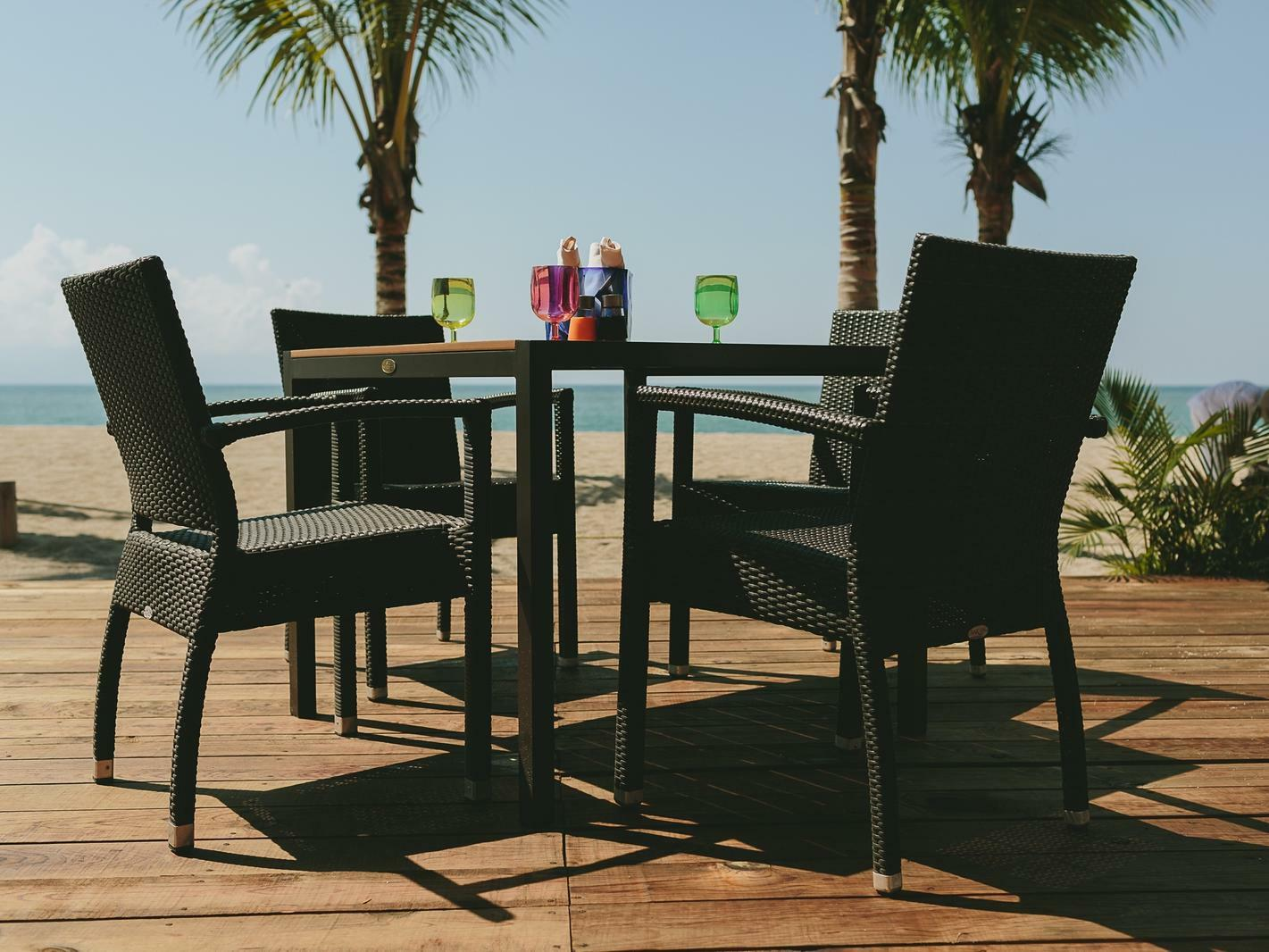dining table on terrace with beach view