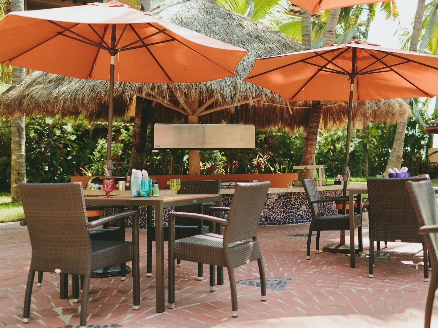 outdoor restaurant with tables, chairs with umbrellas