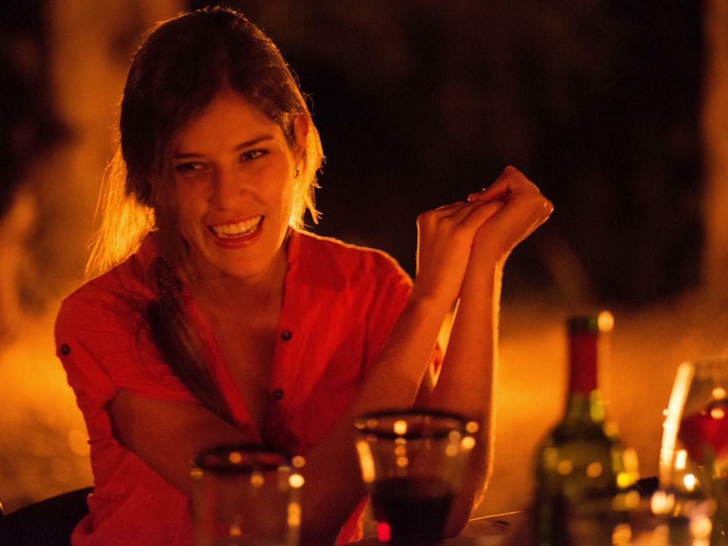 woman smiling at bar