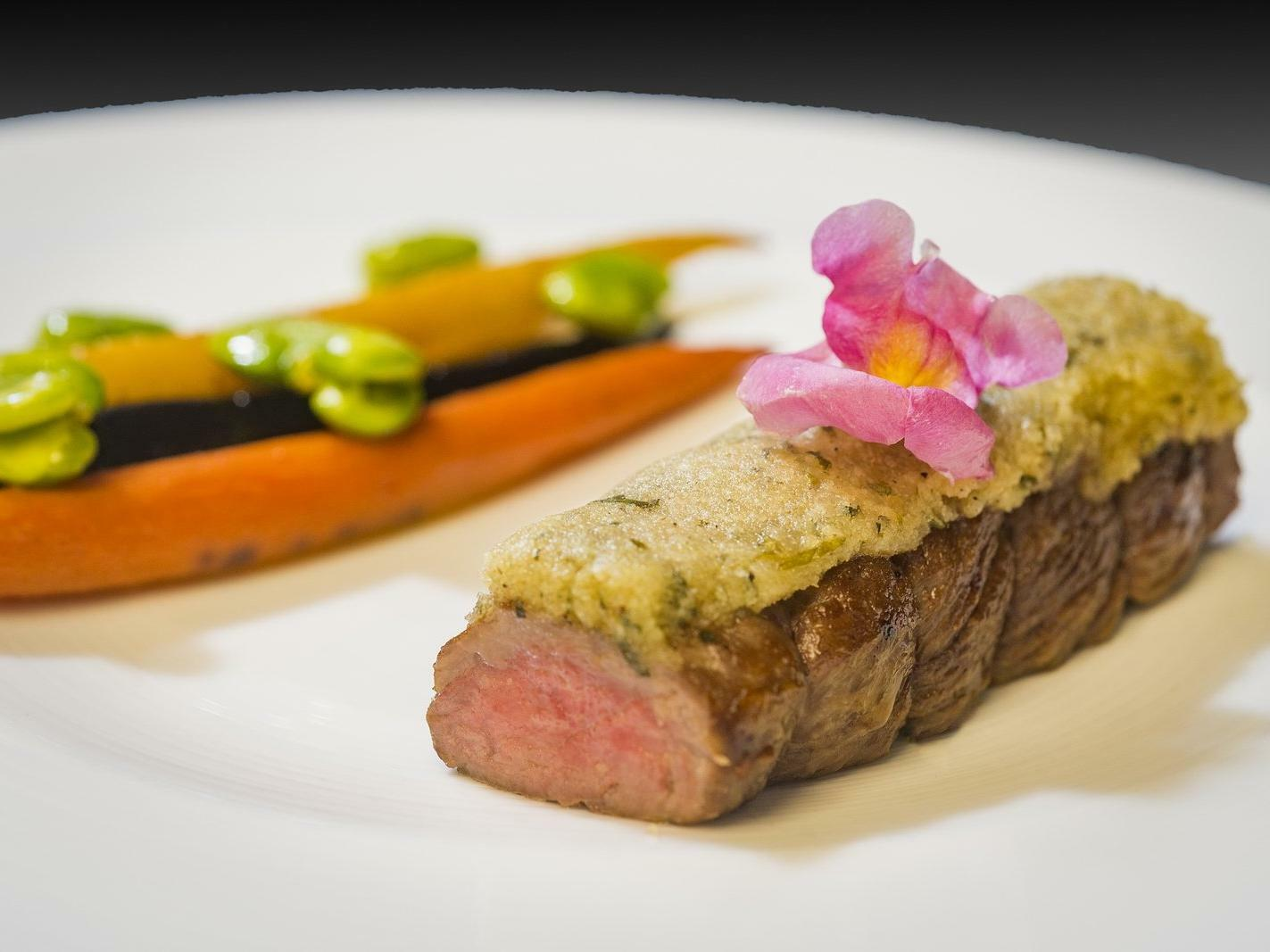 cooked steak and vegetables on a plate