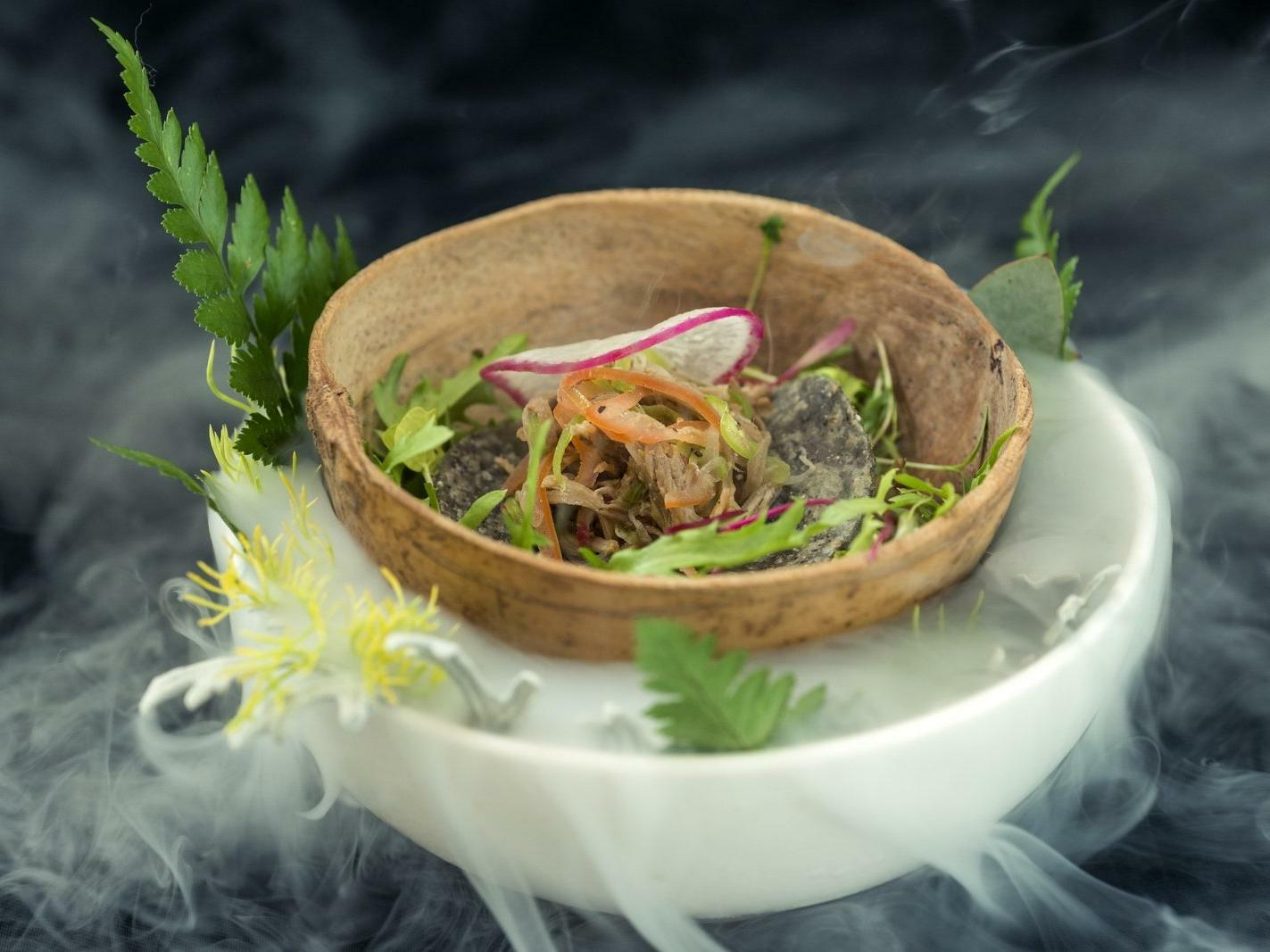 bowl of food over white bowl with smoke billowing out underneath