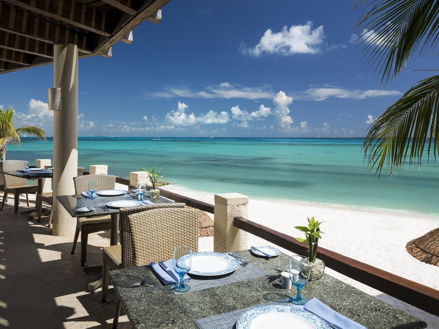 dining tables on terrace view beach view