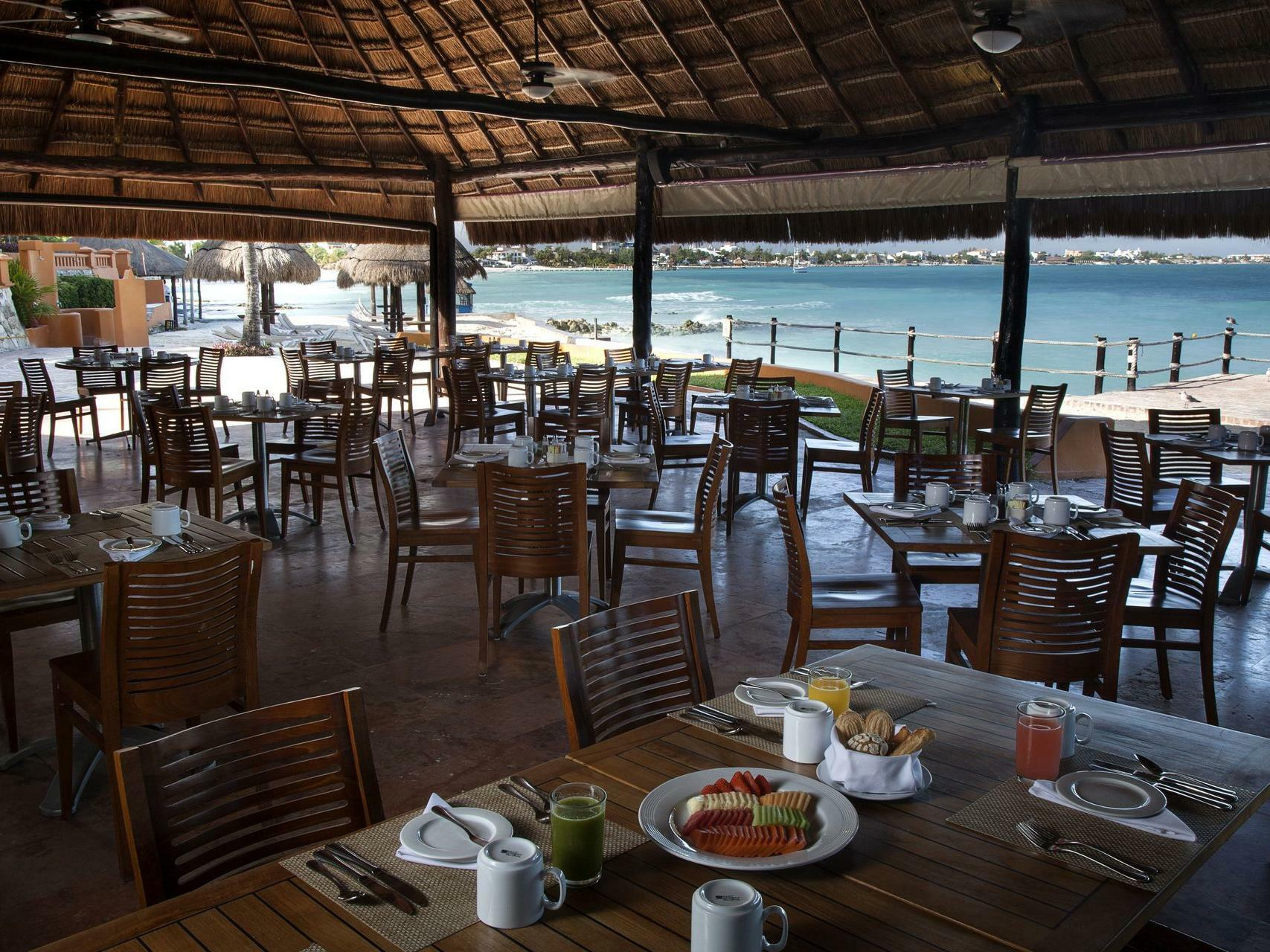 outdoor restaurant with tables and chairs