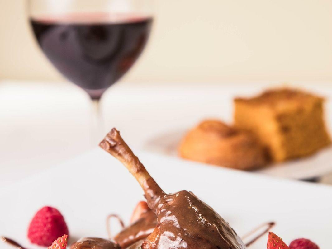 plate of food with wine glass