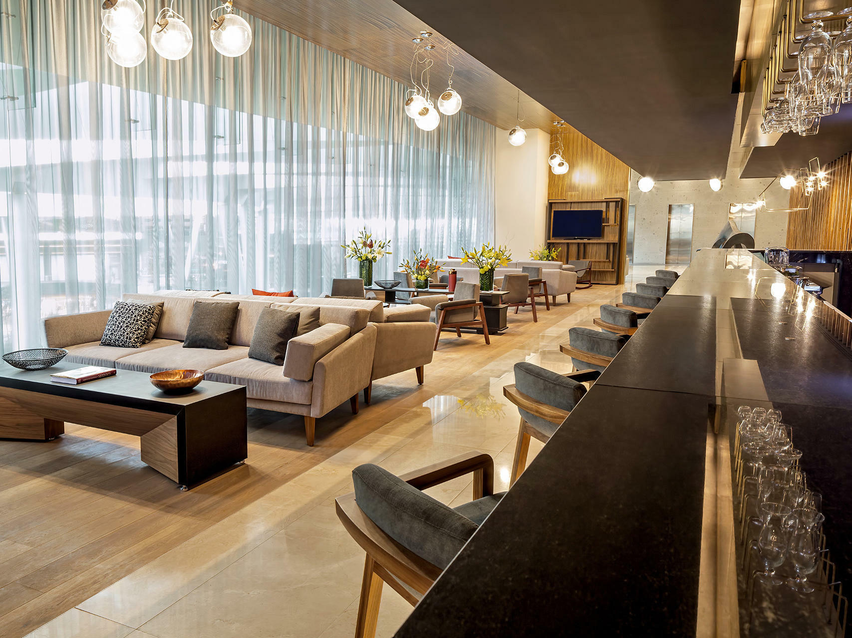 bar with bar stools and lounge seating