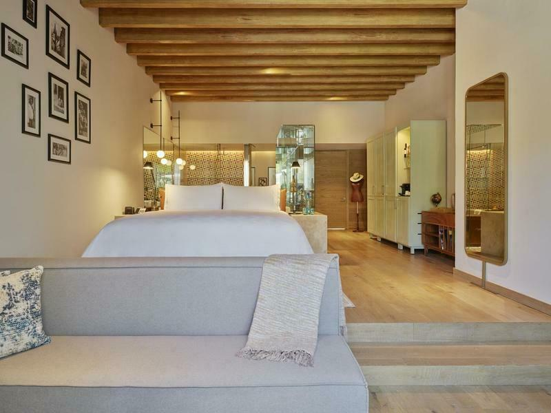 viento suites with bed and glass bathroom walls