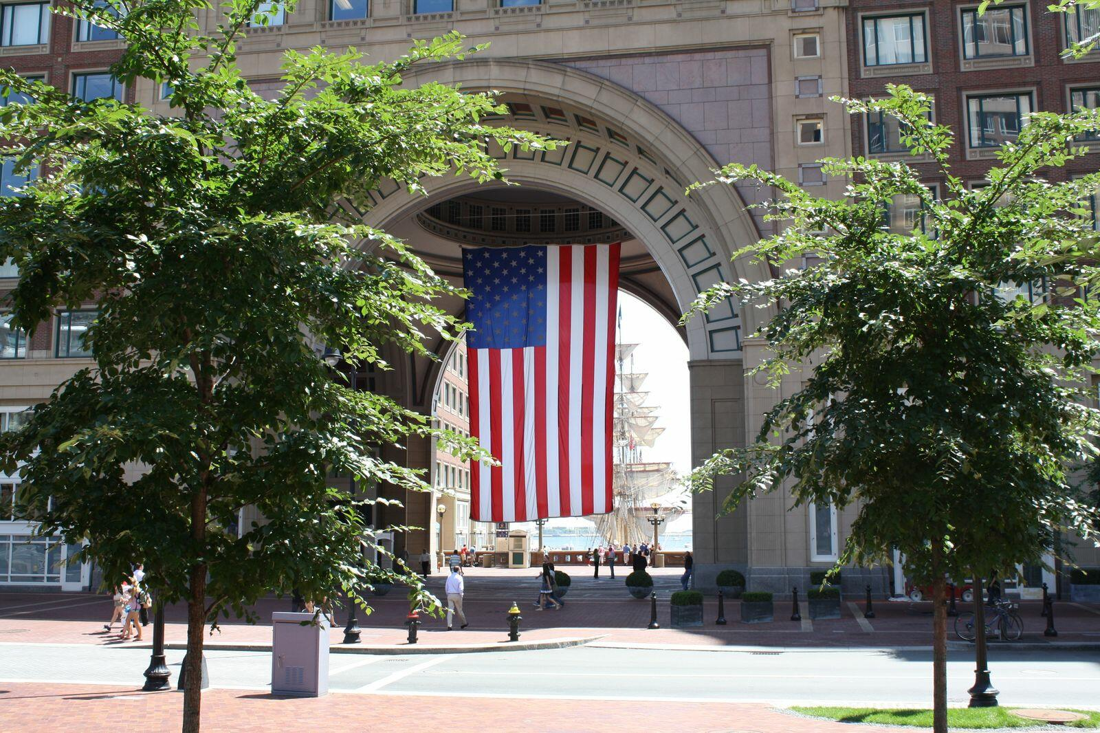 US flag suspended from arch