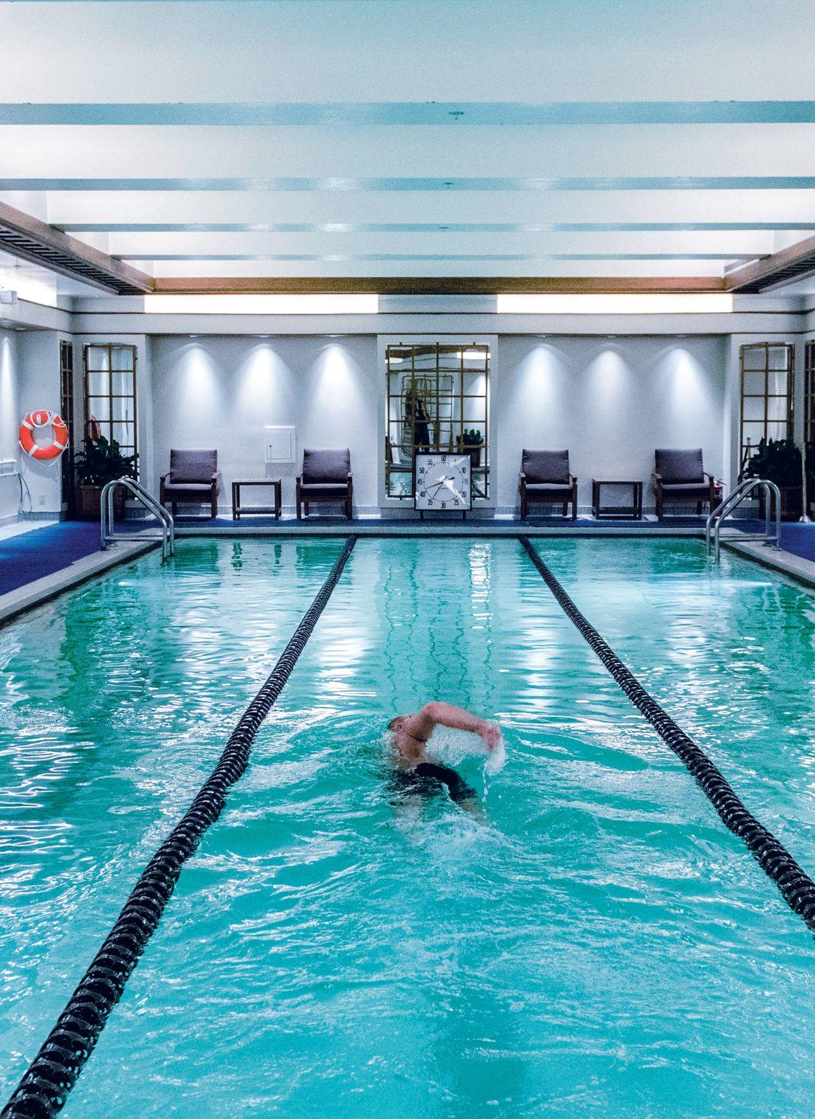 Guest swimming laps in indoor pool
