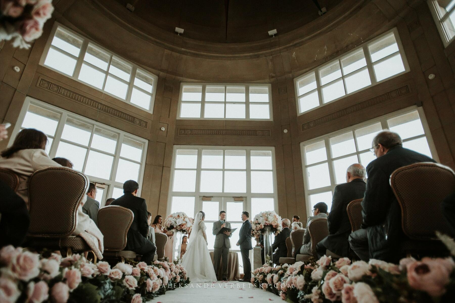 Photo of wedding ceremony with vast windowed light