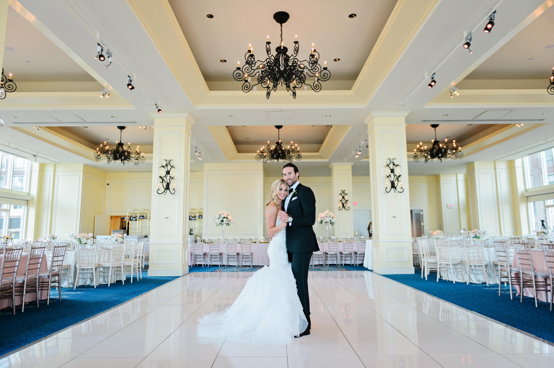 Newlyweds in the middle of a grand ballroom