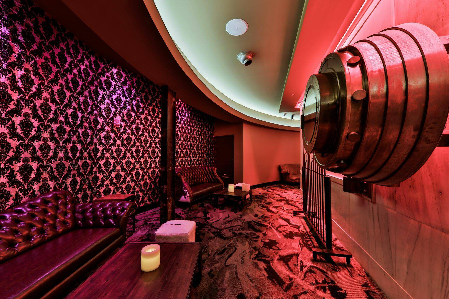 Luxurious seating within the Vault, a premium bar and speakeasy