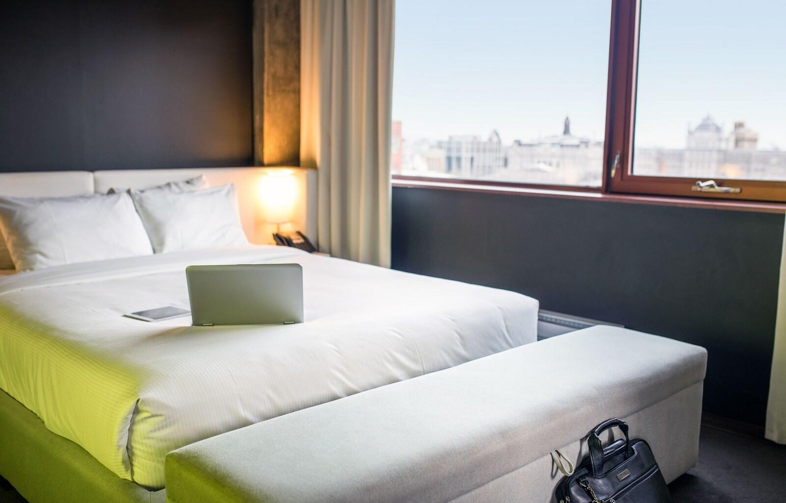 Queen Bed in Room with City Views
