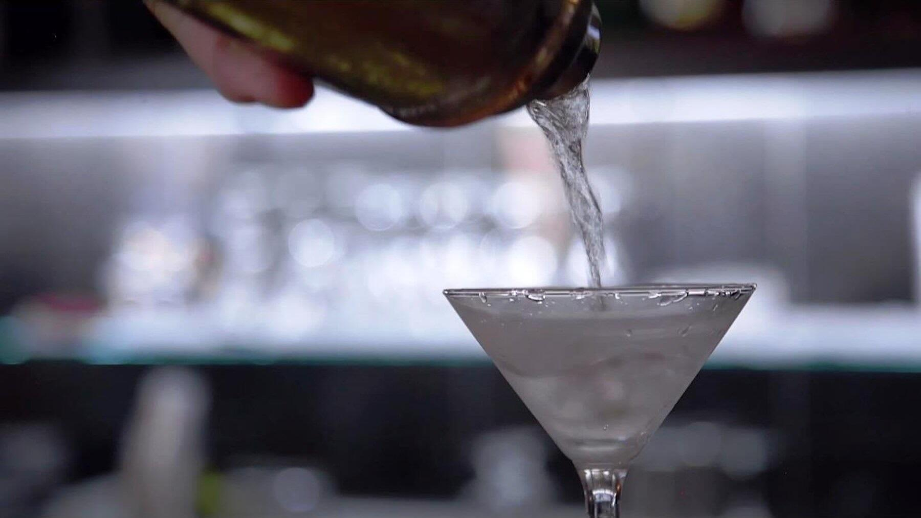 Bartender pouring martini at Congress Lounge