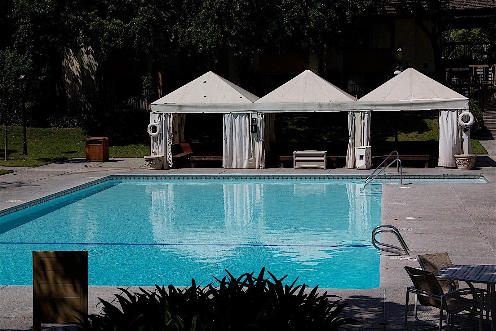 Outdoor Pool with Cabanas