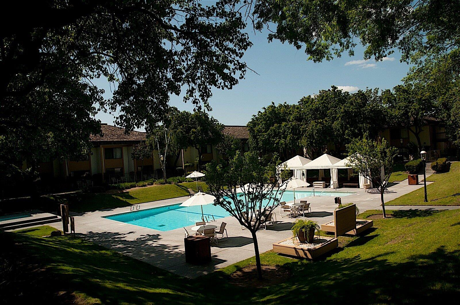 Wide angle view of outdoor pool with cabanas
