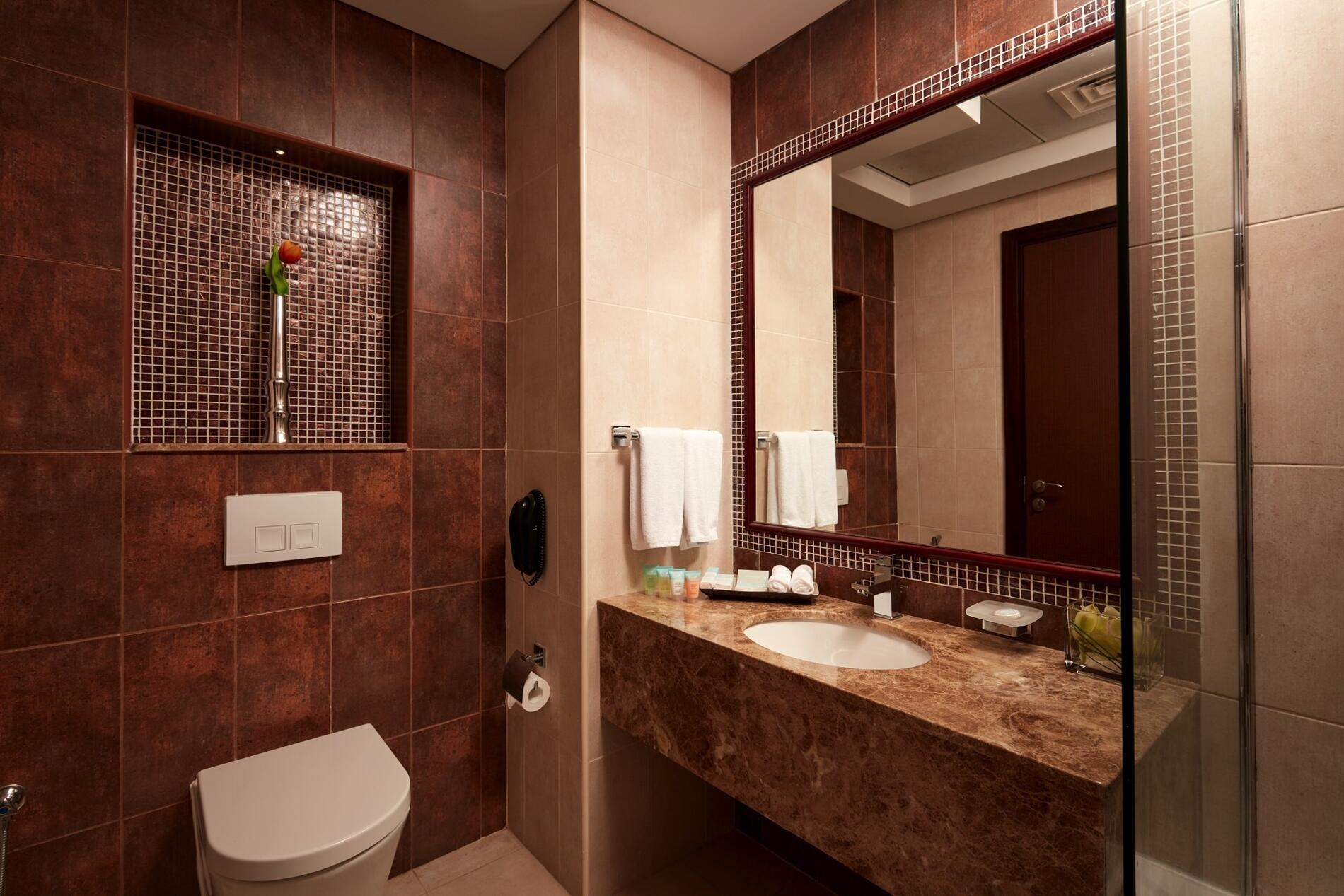 Bathroom at Treppan Hotel and Suites