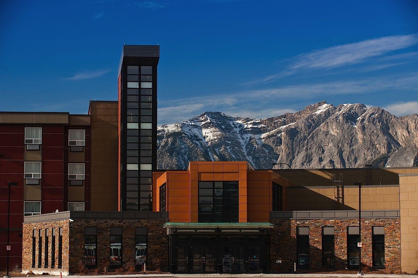 Hotel exterior with mountains in background
