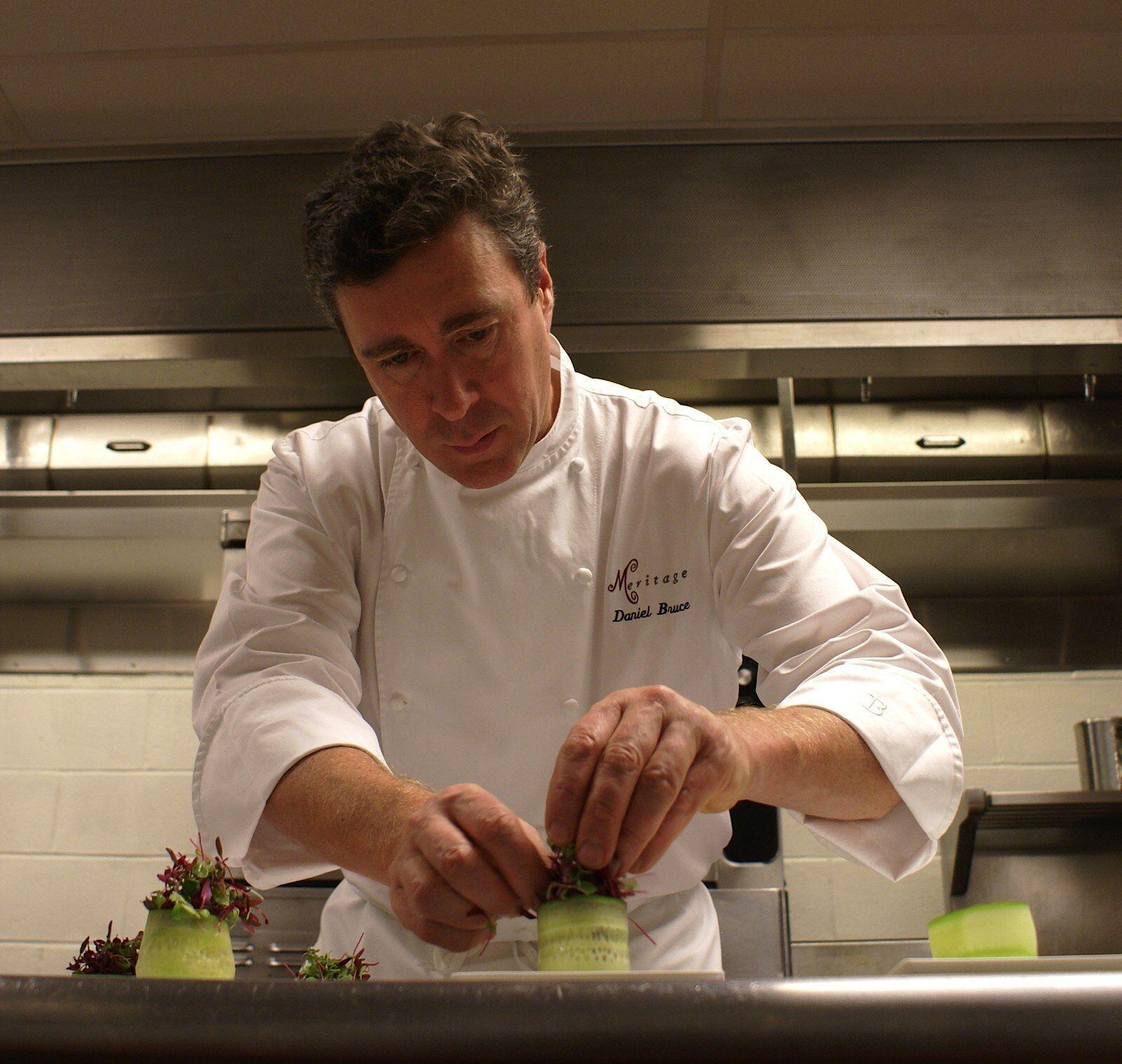 Chef Daniel Bruce prepping a dish