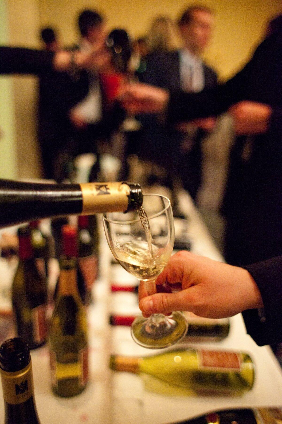 Glasses of wine being poured at an event