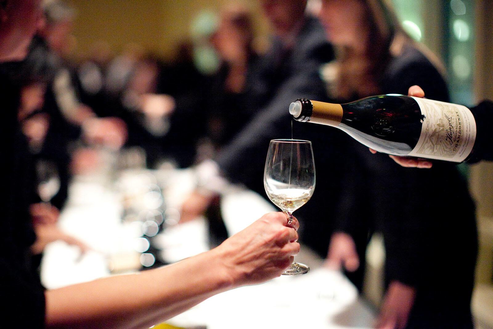 Server pouring wine