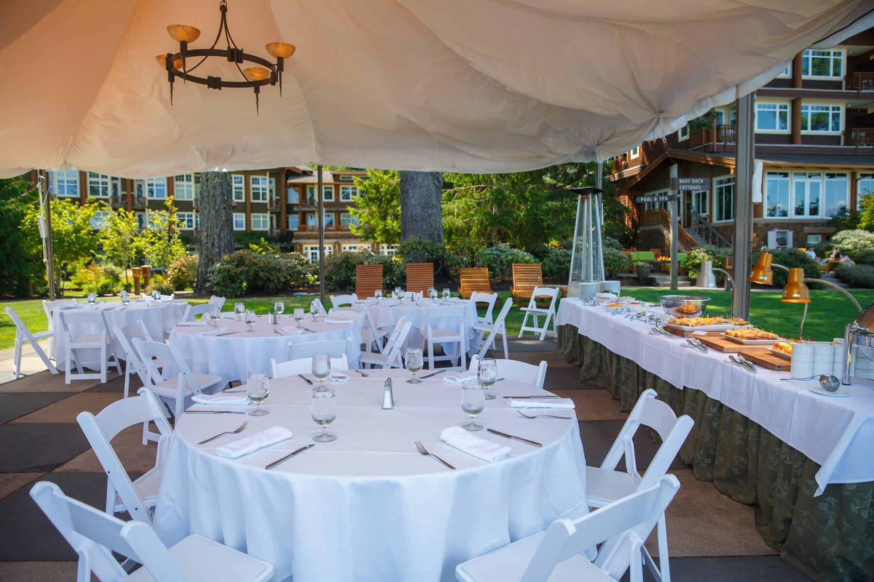 Outdoor event space set with banquet tables