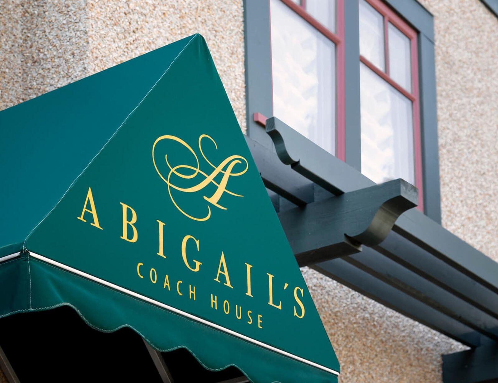 Awning printed with Abigail's Hotel logo