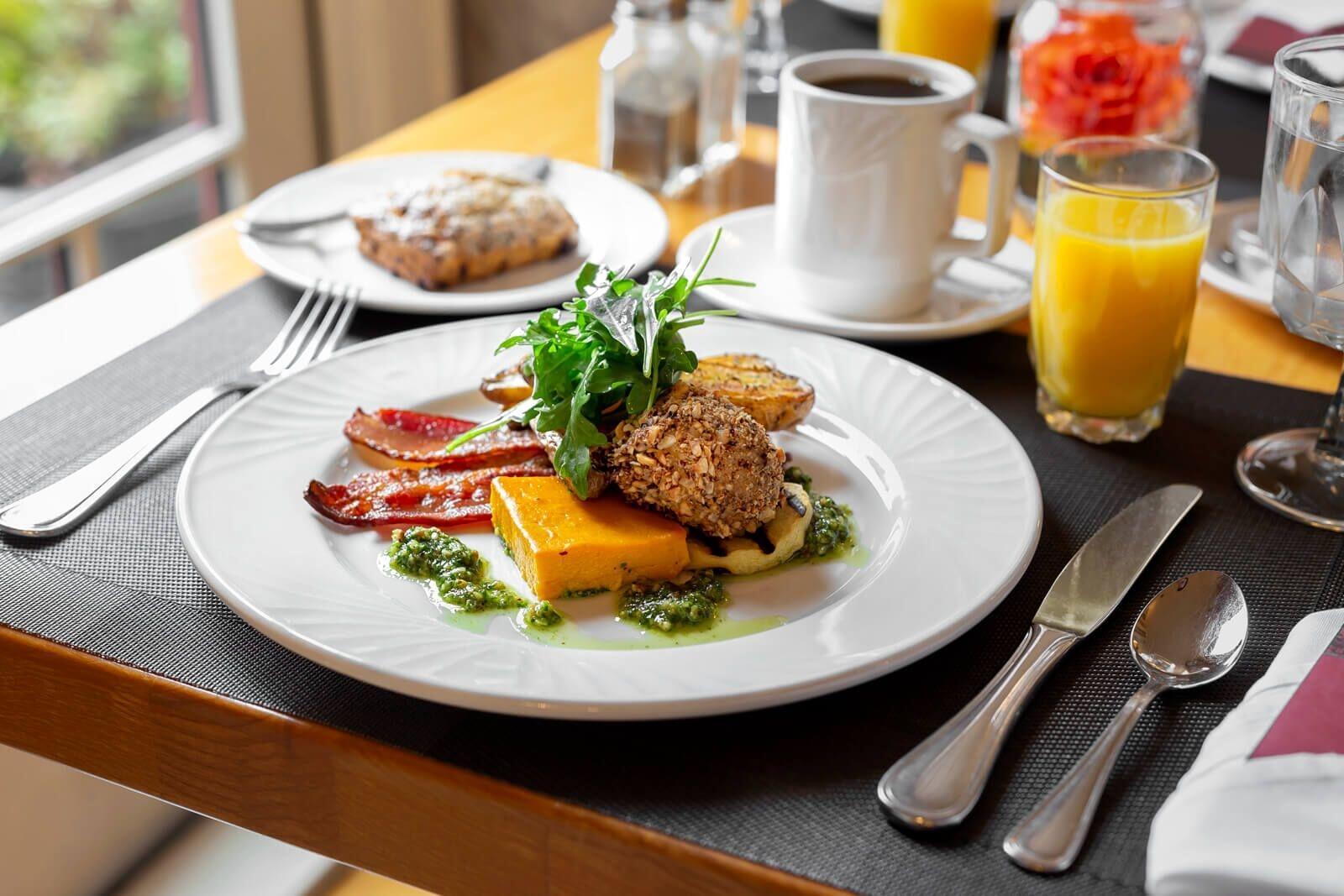 Plated breakfast served with coffee and orange juice