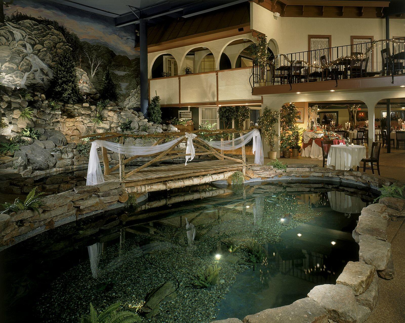 Koi pond with realistic rock outcroppings in courtyard