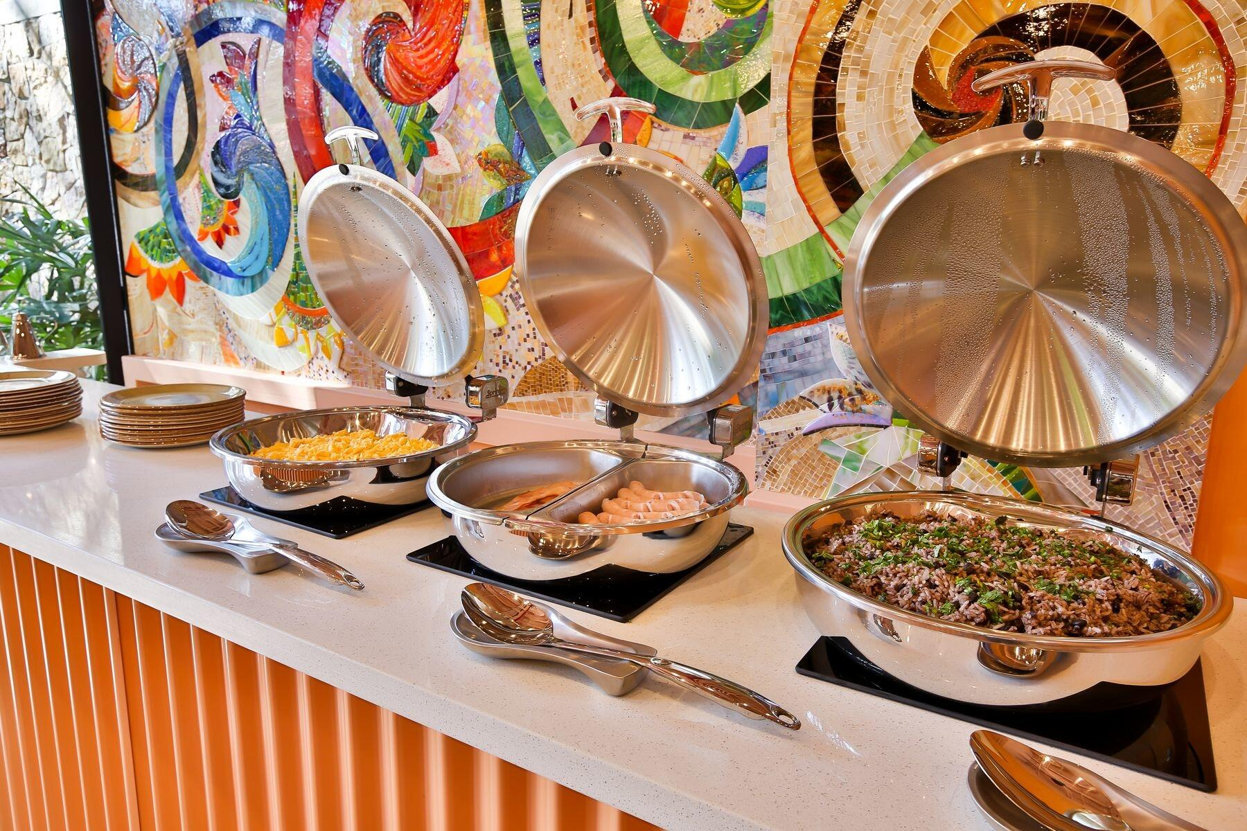 Breakfast buffet served in electric chafing dishes