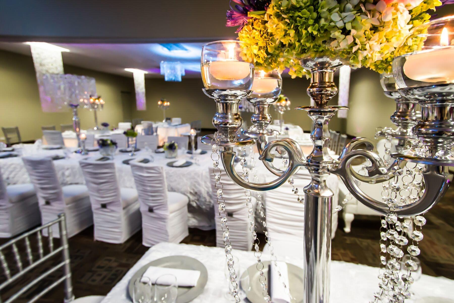 Candelabra centerpiece topped with floral arrangement